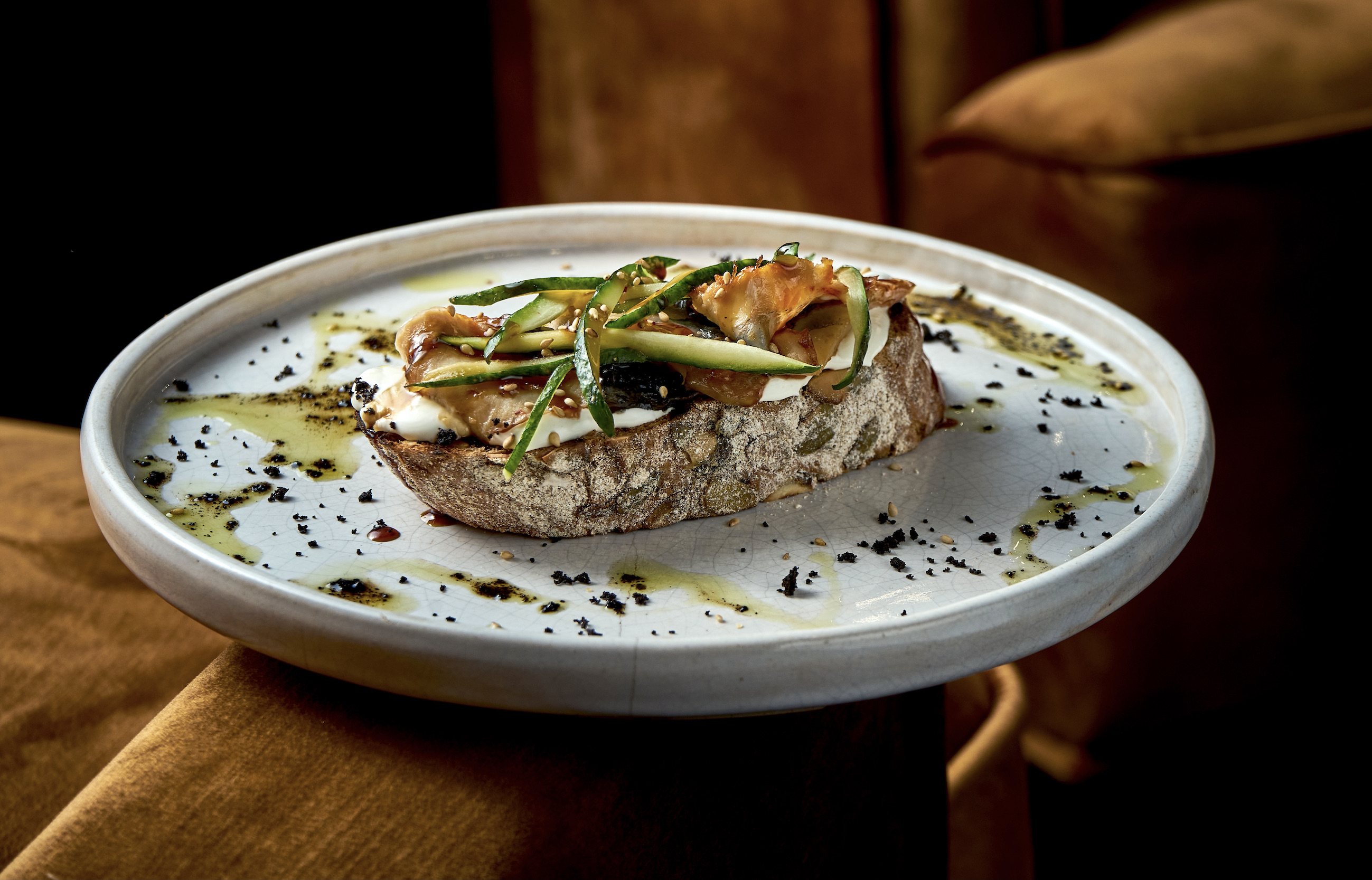 bruschetta-with-eel-cucumber-and-cream-cheese-on-rye-bread-served-in-white-plate-restaurant-food-view-from-above-italian-cuisine 3